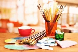 Pencils, brushes, paint, and other arts and crafts tools