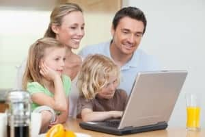 Family using laptop at their Pigeon Forge condo with internet access