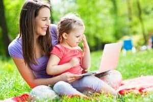 Mother and daughter using laptop outside of their Pigeon Forge condo with internet access