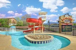 The swimming pool and water slide at Cherokee Lodge in Pigeon Forge.