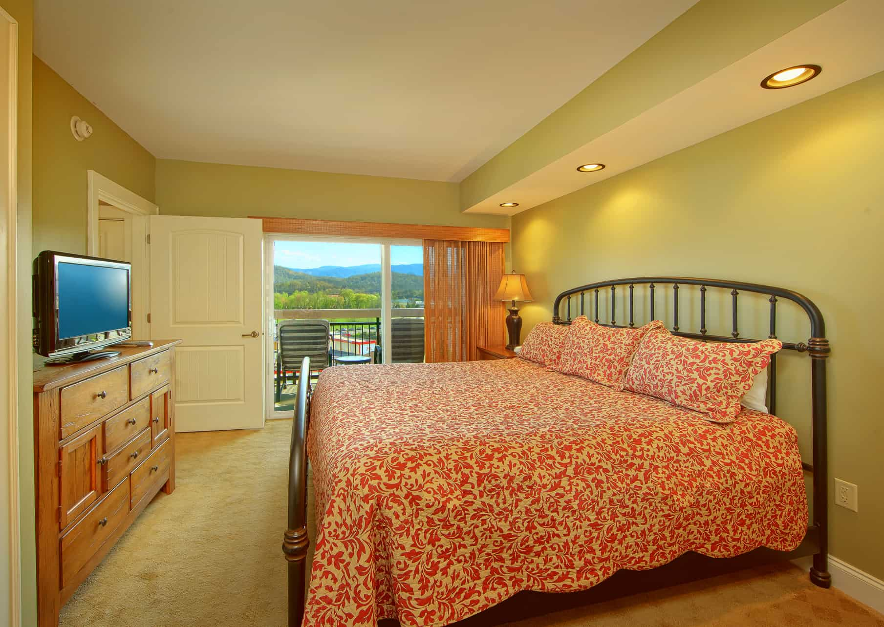 The bedroom of a luxury condo rental in Pigeon Forge with mountain views